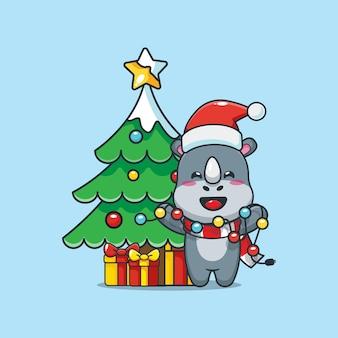 Rinoceronte fofo no dia de natal segurando uma lâmpada de natal ilustração fofa dos desenhos animados de natal