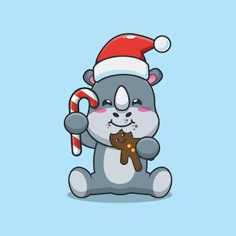 Rinoceronte fofo usando chapéu de papai noel e comendo biscoitos de natal. ilustração fofa dos desenhos animados de natal