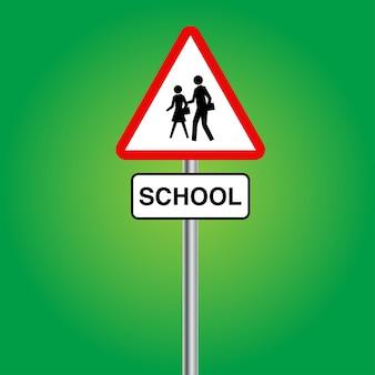 Roadsign escolar ou sinalização para pedestres com mastro prateado sobre fundo verde