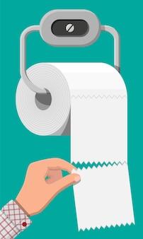 Rolo branco de papel higiênico no suporte. pedaços de papel para o banheiro.