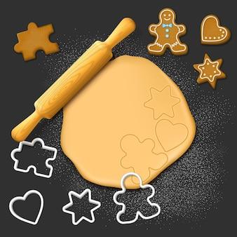 Rolo de massa de madeira e cortadores de biscoitos natal feriado pastelaria doce