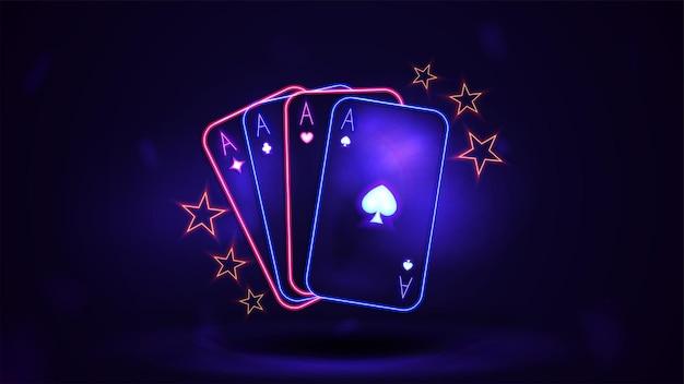 Rosa e azul brilham em néon no cassino jogando cartas no escuro e vazio