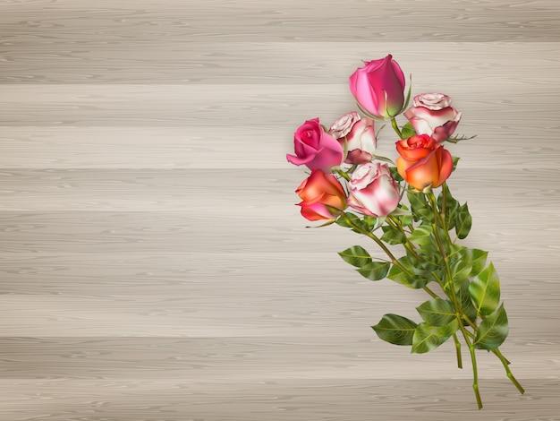 Rosas vermelhas em um fundo de madeira.