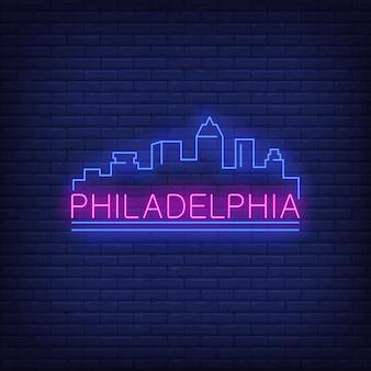 Rotulação de néon de philadelphia e silhueta das construções da cidade. turismo, turismo, viagem.
