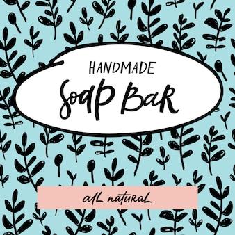 Rótulo de barra de sabão artesanal com letras handdrawn e padrão floral sem emenda