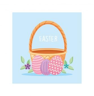 Rótulo de páscoa com cesta de vime e ovos de páscoa coloridos