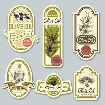 Rótulos de azeite. embalagem de garrafa premium com azeitonas. conjunto de vetores