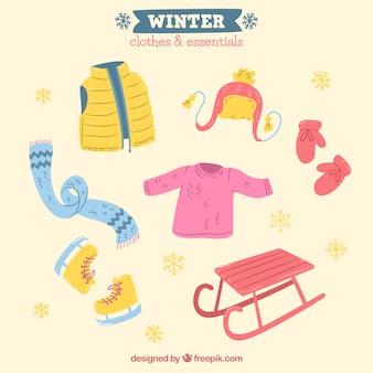 Roupa desenhada mão de inverno e itens essenciais