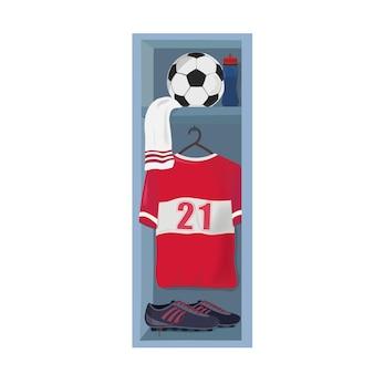 Roupas de futebol e bola no vestiário