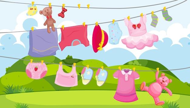 Roupas infantis em um varal com acessórios infantis na cena ao ar livre