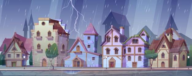 Rua medieval alemã à noite com chuva