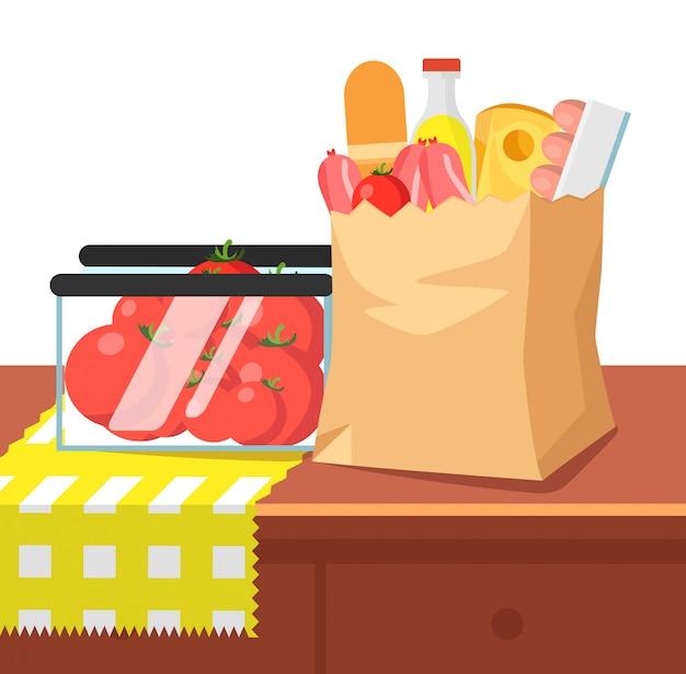 Saco de comida de papel e tomates na mesa