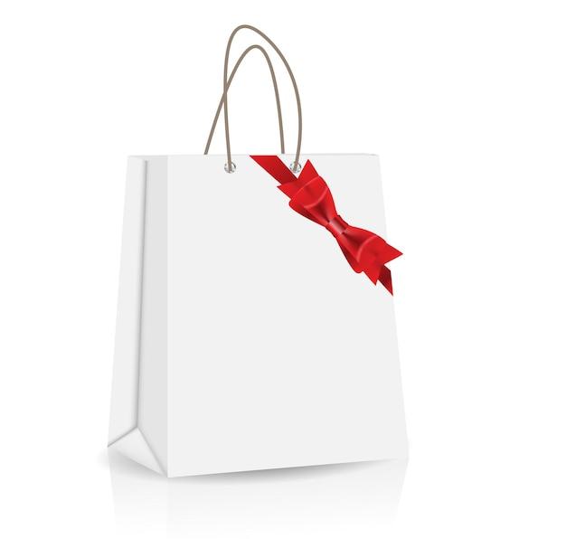 Saco de compras vazio com arco e fita para publicidade e farelo