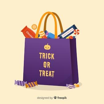 Saco de doces de halloween colorido com design plano