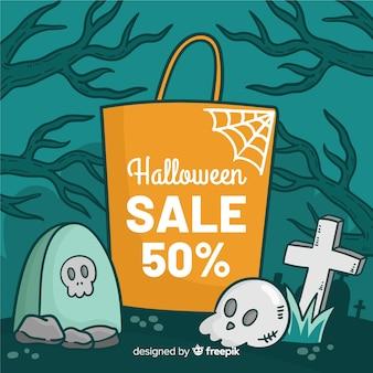 Saco laranja de halloween com vendas