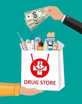 Sacola de compras com comprimidos médicos e frascos