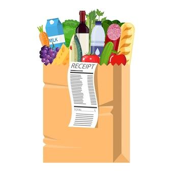 Sacola de compras de papel cheia de produtos de mercearia com recibo