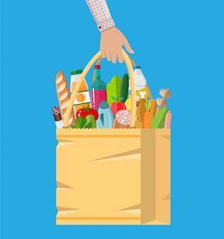 Sacola de papel cheia de produtos de mercearia