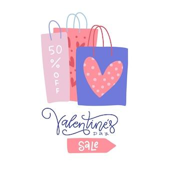Sacolas de compras do dia dos namorados com letras e impressões de coração