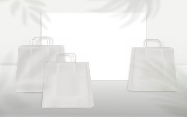 Sacos de papel branco e banner em branco com efeito de sobreposição de sombra