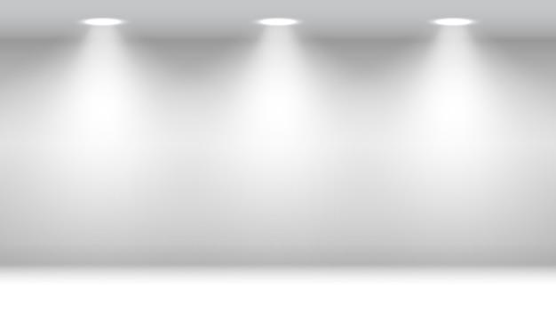Sala branca com holofotes. estúdio em branco.