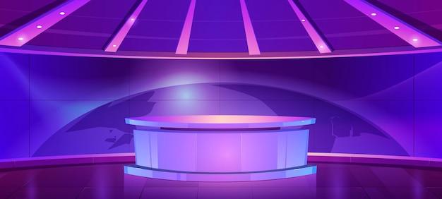 Sala com mesa redonda e tela azul com ilustração dos desenhos animados do mapa-múndi