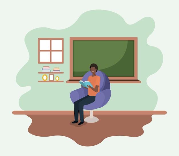 Sala de aula com professor negro lendo livro no sofá
