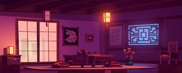 Sala de estar chinesa com mesa de madeira, cadeira e almofadas vermelhas à noite.
