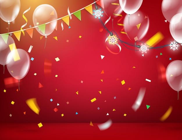 Sala iluminada de vermelho com balões e bandeiras e guirlandas e confetes coloridos