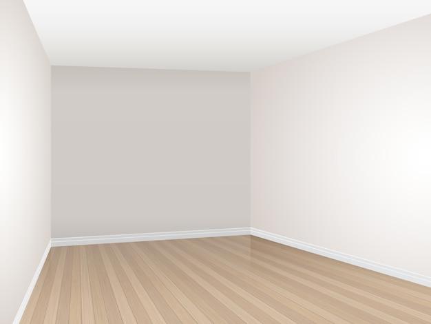 Sala vazia com assoalho de parquet e parede bege.