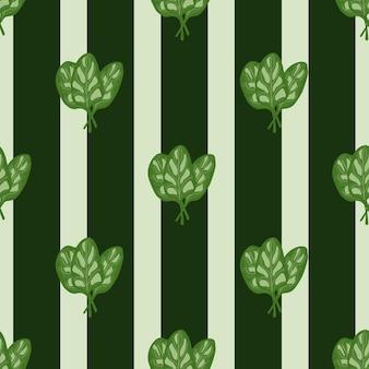Salada de espinafre de grupo padrão sem emenda sobre fundo verde listrado. ornamento simples com alface.