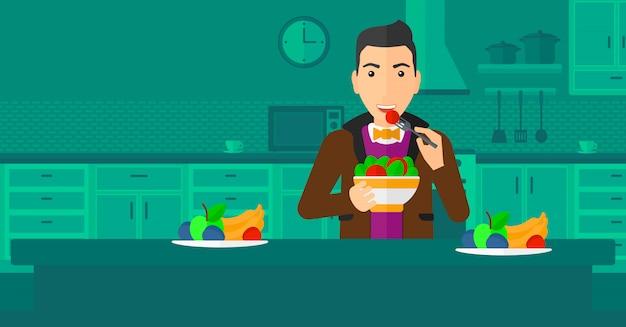 Salada de homem comendo.