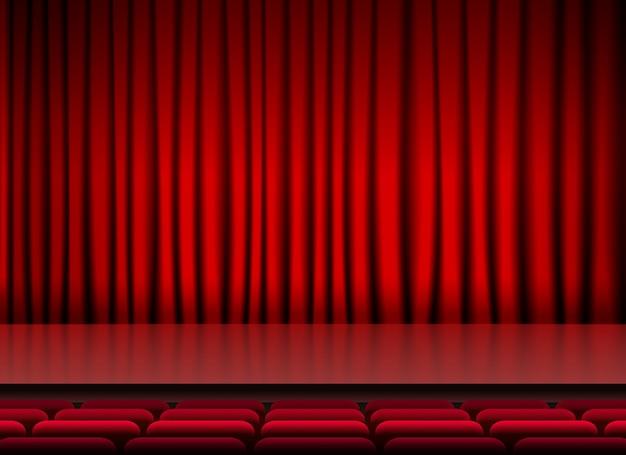 Salão de auditório com cortinas e assentos vermelhos