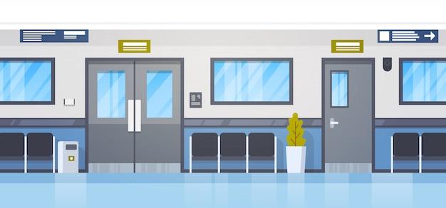 Salão de clininc do hospital vazio com assentos e corredor da porta