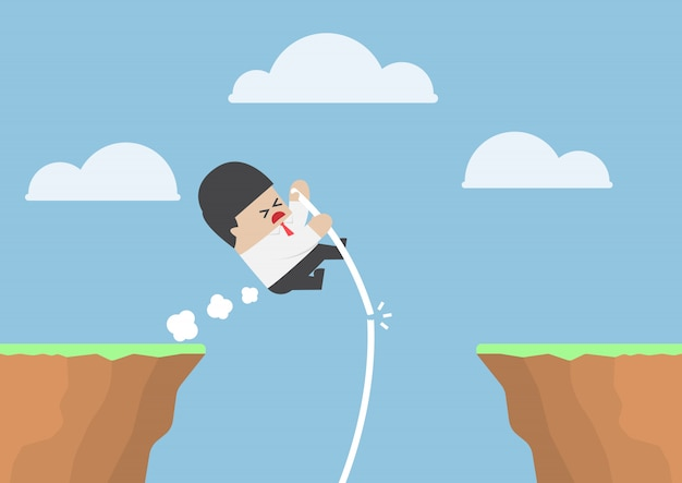 Salto com vara de empresário através do penhasco, mas ele falha
