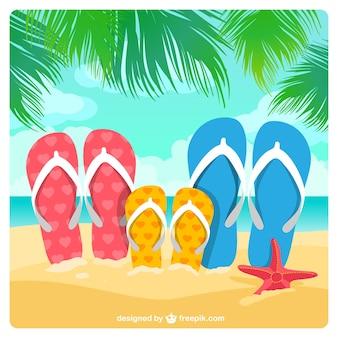 Sandálias da família na areia