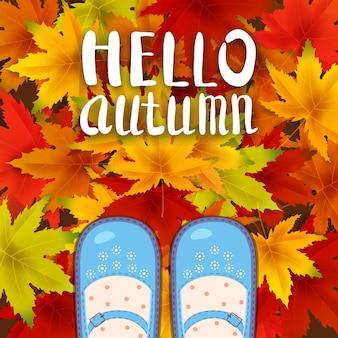 Sapatos femininos azuis nas folhas de outono letras olá, outono