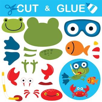 Sapo bonito usando equipamento de mergulho com peixes e caranguejos. jogo de papel para crianças. recorte e colagem.