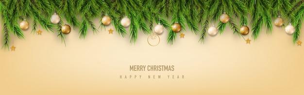 Saudação de feliz natal com galhos de pinheiro e bola de natal