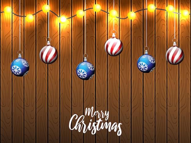 Saudações de natal com fundo de madeira e lâmpada de seqüência de caracteres