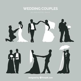 Seis casais de casamento na silhueta