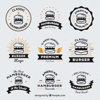 Seleção de nove logos de hambúrguer com detalhes em laranja