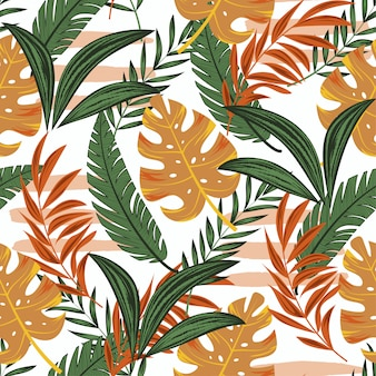 Sem costura padrão tropical com plantas e folhas amarelas e verdes brilhantes