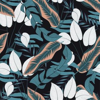 Sem costura padrão tropical com plantas e folhas brancas e azuis brilhantes