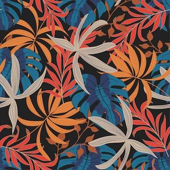 Sem costura padrão tropical com plantas e folhas brilhantes