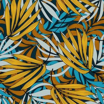 Sem costura padrão tropical com plantas e folhas em tons de amarelos e azuis