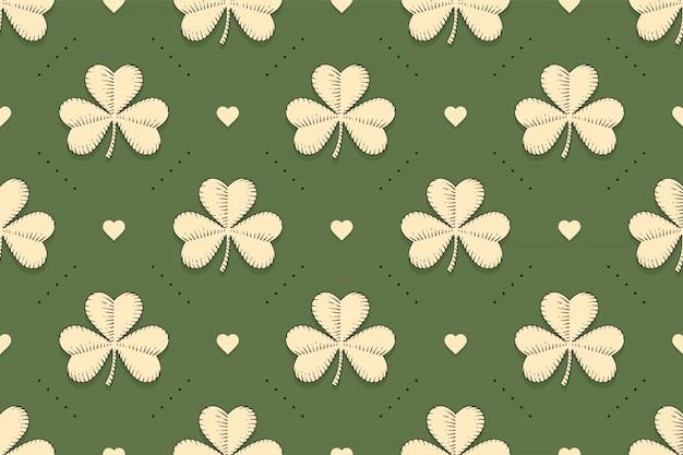 Sem costura padrão verde irlandês com trevo e coração