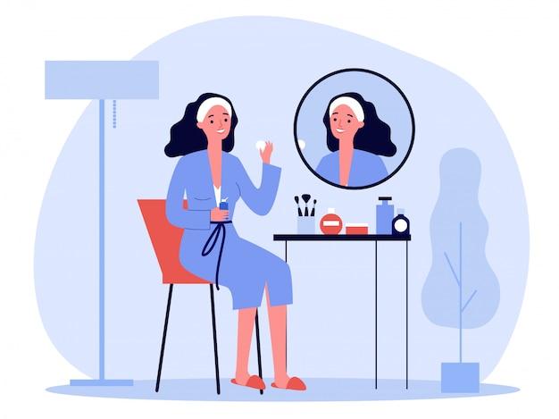 Senhora dos desenhos animados na frente do espelho, lavar a pele do rosto