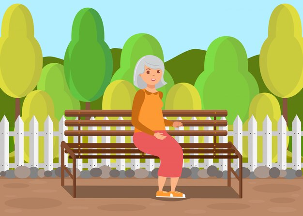 Senhora idosa sentada no banco