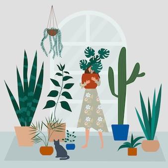 Senhora louca da planta no jardim da casa. uma garota abraça um vaso com uma planta